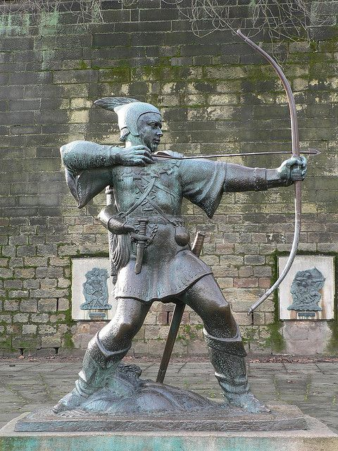 "Robin Hood statue outside Nottingham Castle, Nottingham, UK. Sadly, all just a myth. Robin Hood the name was simply derived from a euphemism for a bandit or rather a term used to describe a ""robbing hood"". The term referred to any such criminal and appeared fairly commonly in the Middle Ages"