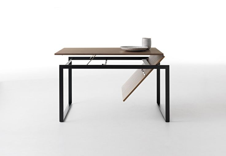 Wow Plus by Horm it A table of simple and elegant design, also suited for cramped environments, where it can be extended at will in a few seconds using the 80 cm supplied extension. By turning a frame knob, the extension appears almost magically while the main table top remains horizontal, hence usable, during the extension process.