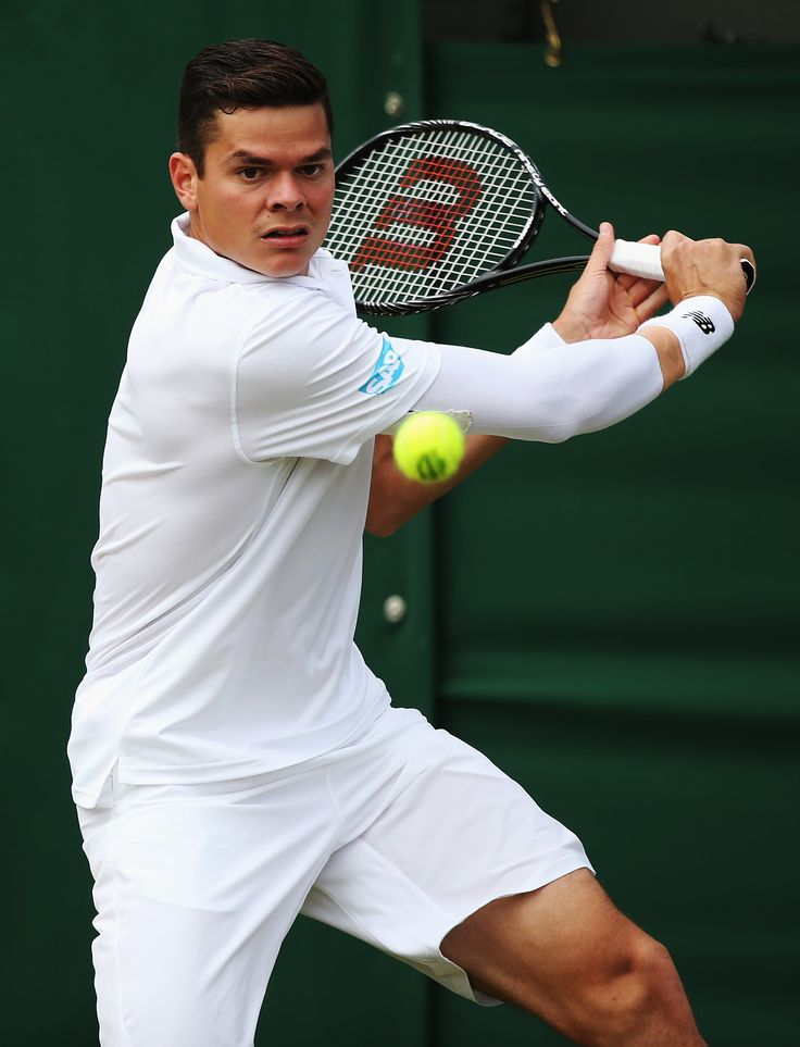 Milos Raonic of Canada in action during his Gentlemen's Singles second round match against Jack Sock of the United States on day four of the Wimbledon Lawn Tennis Championships at the All England Lawn Tennis and Croquet Club at Wimbledon on June 26, 2014 in London, England. (Photo by Steve Bardens/Getty Images)