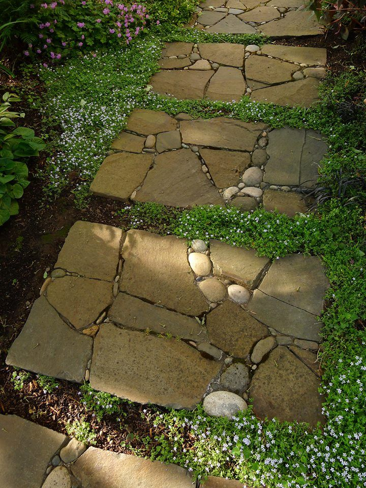 We love the way the path in this garden looks like traditional square step stones . . . but isn't. The small round stones dropped into the design add creative interest.