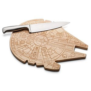 "This cutting surface inspired by the fastest ship in the galaxy is made from wood and measures roughly 10 1/2"" x 14 1/2""."