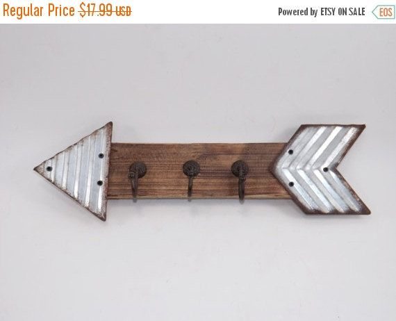 Corrugated metal tipped wood arrow wall hook. Triple hooks on wood center. Tips or the wood or both can be painted in your choice color/ colors