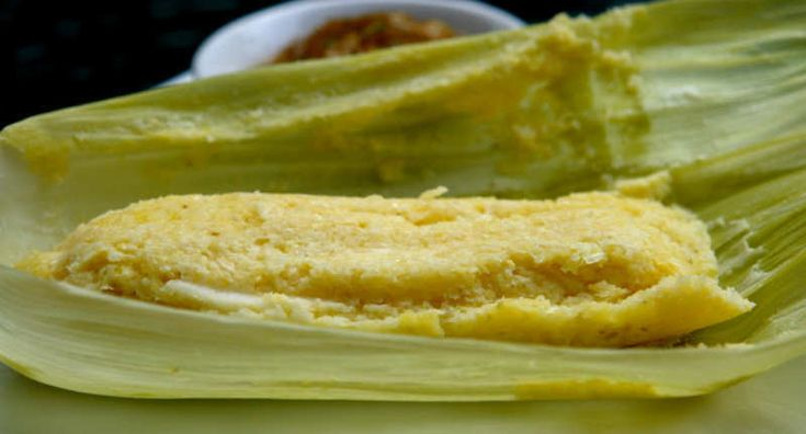 Humitas are an early, pre-Hispanic food that is still popular today. They are similar to Mexican tamales. Fresh corn is ground and mixed with salt and lard (and seasoning and cheese in this case), and the mixture is wrapped in corn husks and steamed. Serve them with salsa criolla.