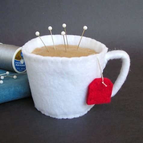 It's hand-stitched and made of felt. I filled it with emery to keep pins sharp. I've also made coffee and latte cups. :) I purchased a pattern for felt drinks (for kids play food...