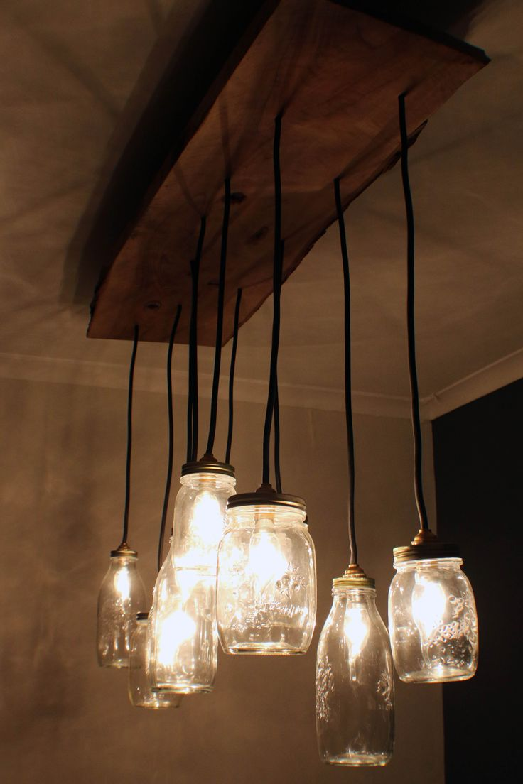 MK Design dining table lamp. Made out of solid olive wood and glass jars.