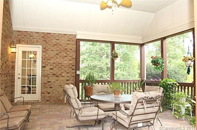Traditional Porch with French doors, Vaulted ceiling, Primitive planters macrame plant hanger, Brick exterior, Screened porch