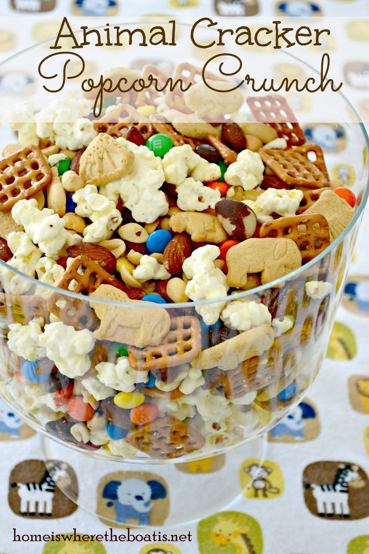 Animal Cracker Popcorn Crunch, animal crackers, nuts, pretzels and white chocolate popcorn for a crunchy mixture of salty and sweet! Link includes other baby shower recipes and ideas for a safari themed baby shower! #babyshowerideas