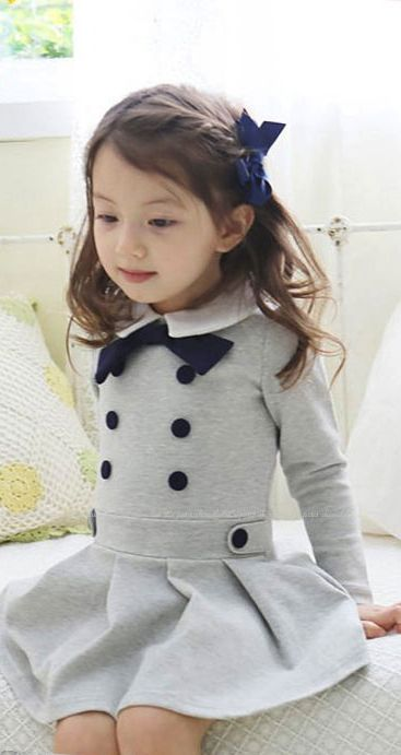 Playtime with belt band, collar, bow, buttons, skirt done in big pleats. In knit.