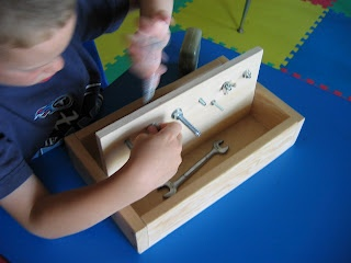 Wildflowers and Marbles: Montessori Homemade! Nuts and Bolts - storage for the tools is built into the caddy, very smart