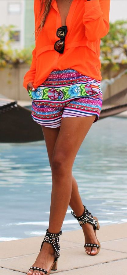 Orangey! Love the patterned shorts and black studded sandles