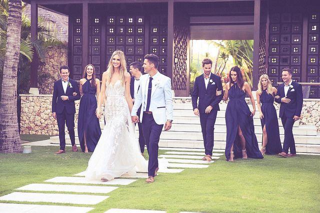 The wedding entourage in a modern #nautical themed #wedding with blue and #white combo #attires // #groom #groomsmen #bride #bridesmaids #wellgroomed #wellgroomedgroom #celebrity #bali #outdoor #garden #clifftop #wedding #baliweddings #destinationweddings // See more at http://www.wellgroomedblog.com/2015/07/well-groomed-groom-bali-destination.html