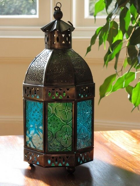 Small iron lamp with blue and green glass. http://www.maroque.co.uk/showitem.aspx?id=ENT06140&s=21-40-154