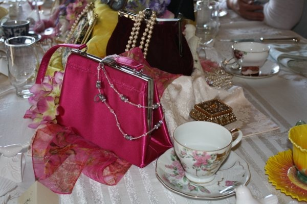 """A Lady's Tea Hosted by Monica Guinan and Lisa Kurtz: By Amyanne Rigby. *My invitation read: """"You are invited to celebrate the coming of spring by enjoying a mid-day break from the usual routine. A Lady's tea will be served with a bit of old fashioned, casual elegance and the comfort of gathering with good friends. We would be thrilled to have everyone embrace this opportunity to flaunt their favorite; spring hat, gloves, pearls, or grandmother's broach."""" *The first question of..."""