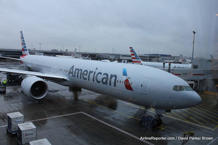 Boarding An American Airlines Plane   american airlines boeing 777 300er at a cloudy jfk american