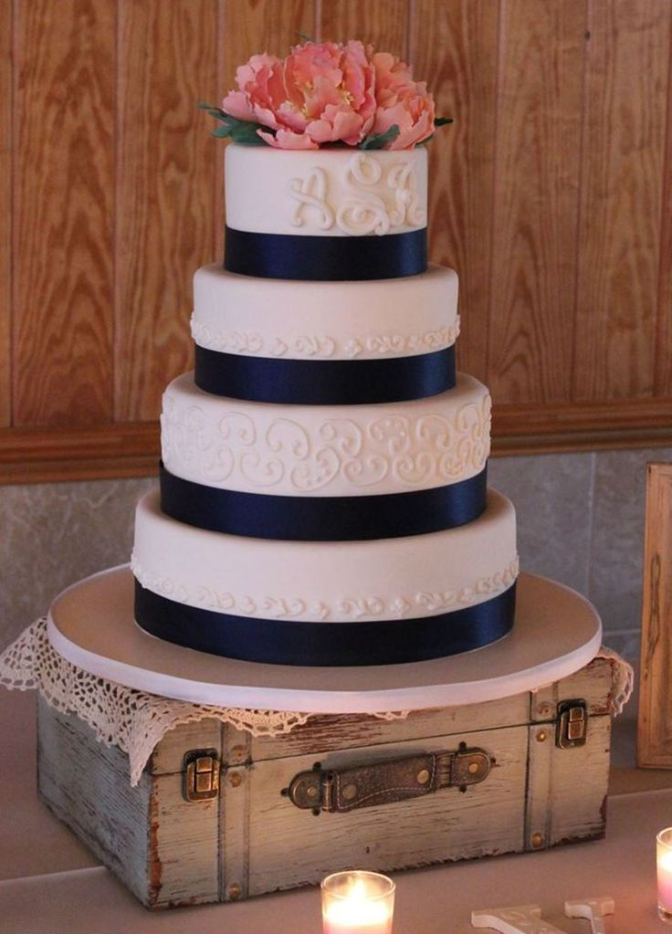 Navy & Coral Wedding Cake Loved working on this romantic wedding cake! Pumpkin spice with cinnamon cream cheese, chocolate with caramel...