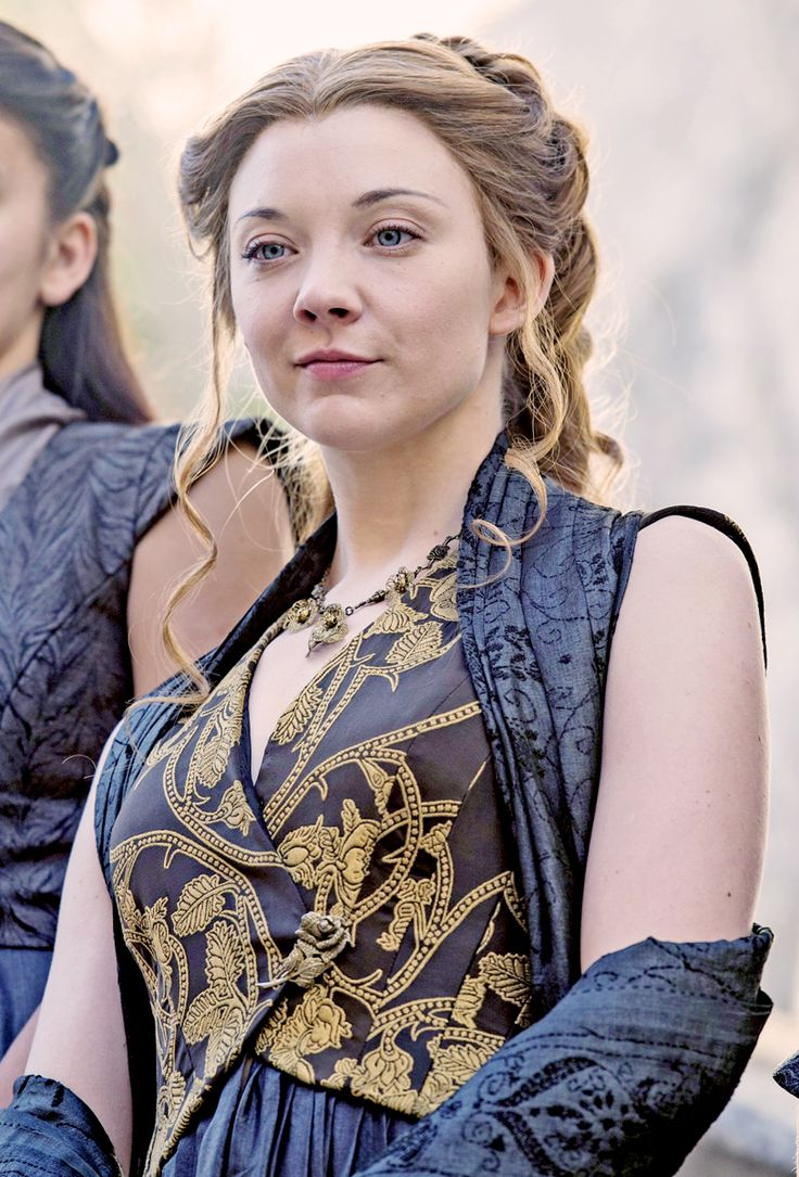 """""""When the doors were opened the Tyrells were amongst the first to enter,  as befit their rank. Margaery had brought a great bouquet of golden  roses. She placed them ostentatiously at the foot of Lord Tywin's bier  but kept one back and held it beneath her nose as she took her seat. So the girl is as clever as she is pretty. Tommen could do a deal worse for a queen. Others have."""""""