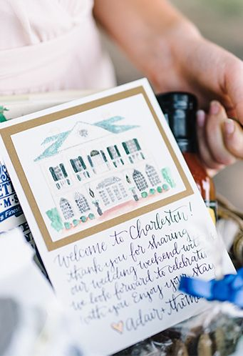 Gift bags full of Charleston,  SC specialty products with a watercolor Lowndes Grove card | Charleston-inspired tips to make your destination wedding #1 | Photo by Rach Loves Troy Photo + Cinema