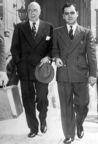 Mob boss Nucky Thompson, who ran Atlantic City during the 20s and 30s, is handcuffed to the United States Deputy Marshal.