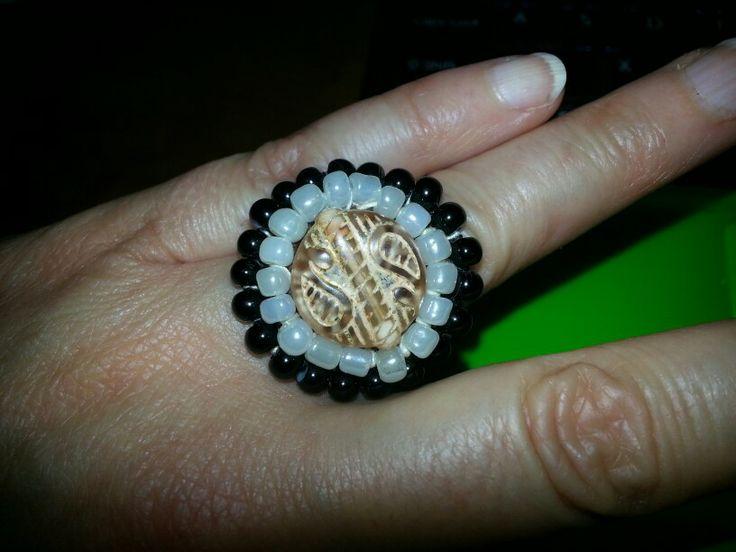 Caramel white and black glass beads on crochet ring