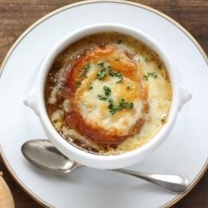 Caramelized onions are simmered for hours in the slow cooker with flavorful beef broth and topped with cheese for a deliciously easy French onion soup recipe.
