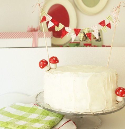 Adorable Mushroom Red and White Mushroom themed cake with garland