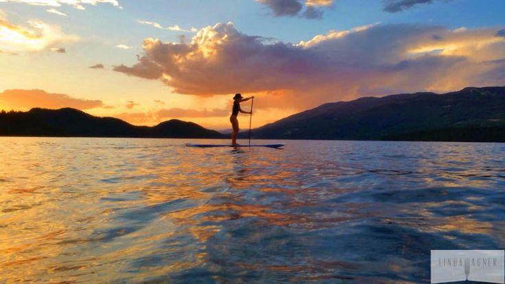 Linda Wagner paddle boarding in Whitefish Lake, MT