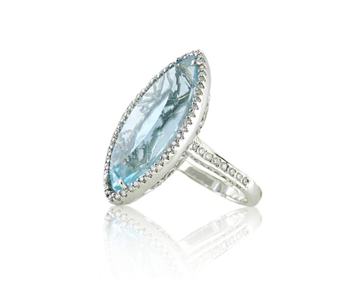 An 18ct White Gold, Blue Topaz and Diamond Dress Ring