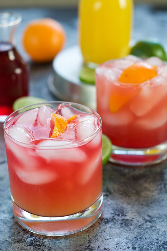 This Skinny Hurricane Cocktail is a healthier version of the classic Mardi Gras drink is filled with orange and cranberry juice and finished with light rum for a refreshing cocktail!