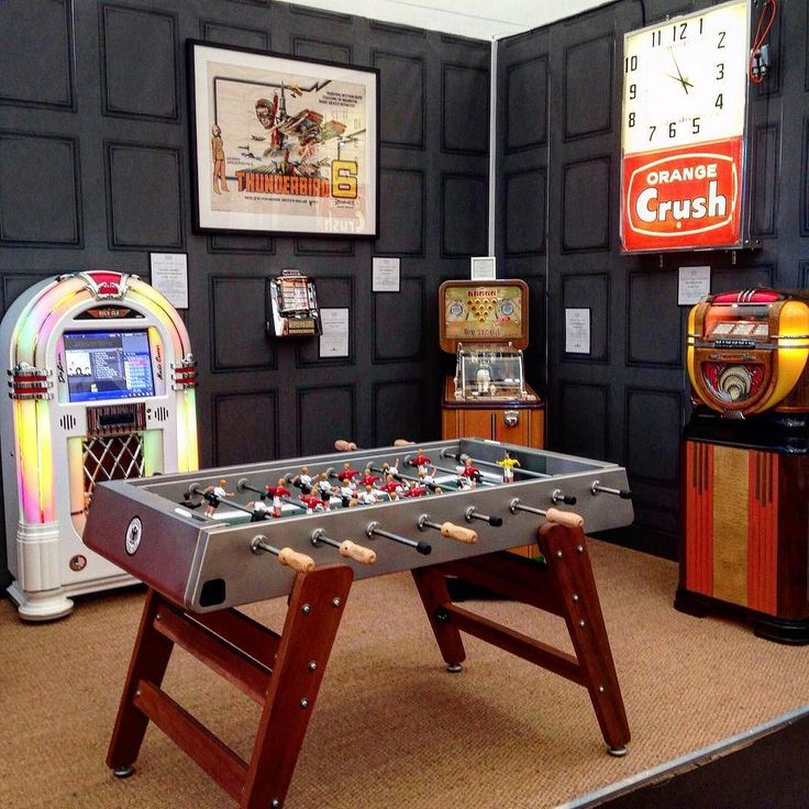 #throwbackthursday to @decorex_international at the start of the month. Here you can see our 50th anniversary edition RS3 football table Rock-Ola Bubbler jukebox Evans bowling machine and Wurlitzer model 71 jukebox. #decorex2016