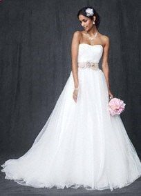 Dramatic, elegant, and ultra-feminine! This strapless tulle wedding dress is perfect for the bride who wants to look and feel like a princess! Strapless ball gown features figure flattering ruched bodice detail. Stunning full tulle skirt is truly breathtaking. Sweep train. This one is gorgeous!!