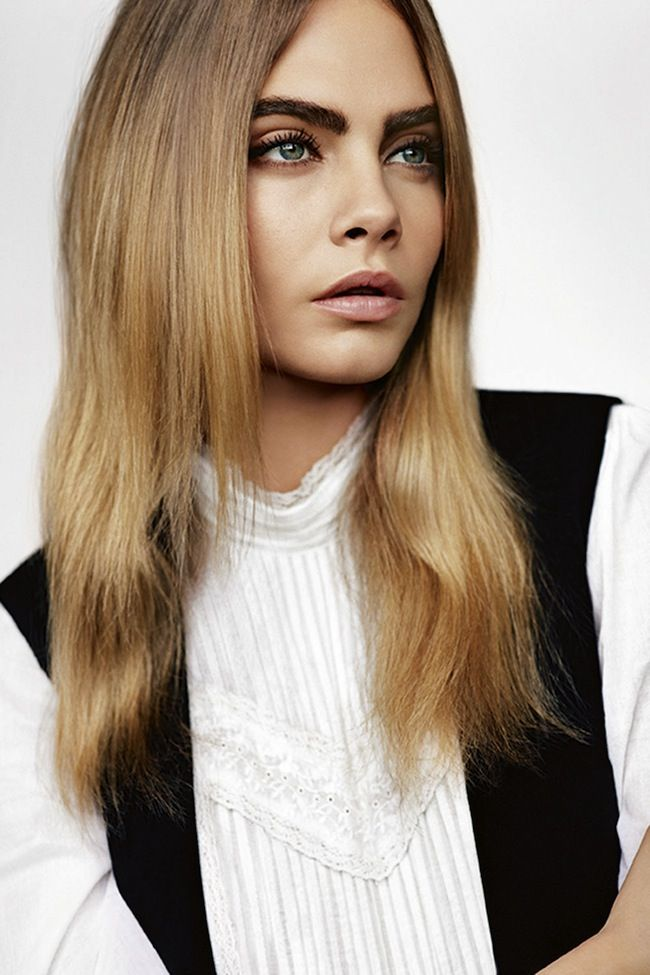 Cara Delevingne in a white top with lace detail for Topshop's S/S '15 campaign