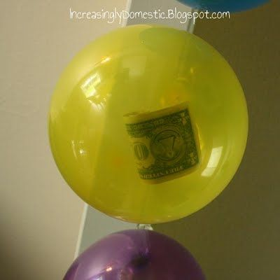 What a great birthday idea!  One dollar for each year in separate balloons.  Then they pop them after cake and presents. From Increasingly Domestic blog.