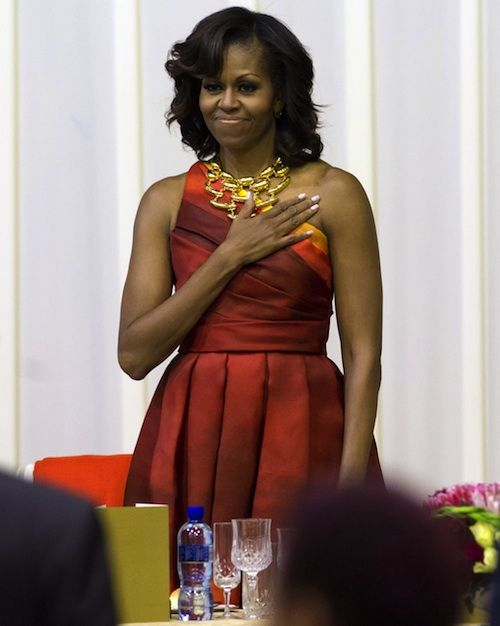 First Lady Michelle Obama wearing a Naeem Khan Spring 2013 sunset print one-shoulder gazar cocktail dress