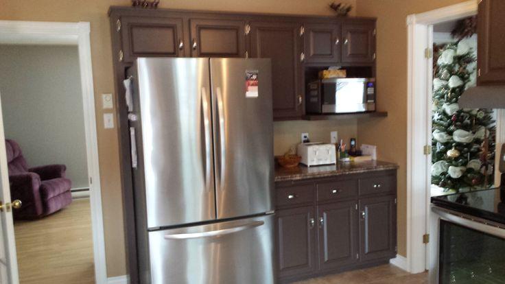Kitchen cabinets sprayed to a dark color