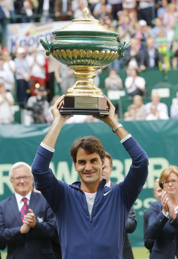 Switzerland's Roger Federer lifts the trophy after winning the final of the Gerry Weber Open tennis tournament in Halle, Germany. (AP)