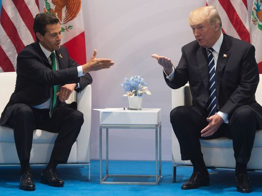 President Trump sat down Friday with Mexico counterpart and frequent political rival Enrique Pena Nieto, a meeting that appeared to do little to bridge the gap between the two leaders on Trump's proposed border wall.