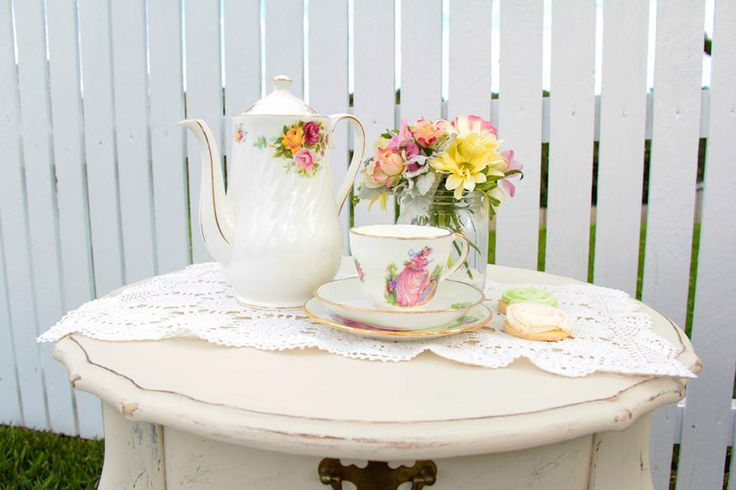 Beautiful table and tea set and flowers to compliment them.  -Styled By- Rahenna's Floral Design, Sweet Sister Cookies & Sweet Treats, Paper Blossom Creations, Sweets & Tea, photos by Brad Razz Photography