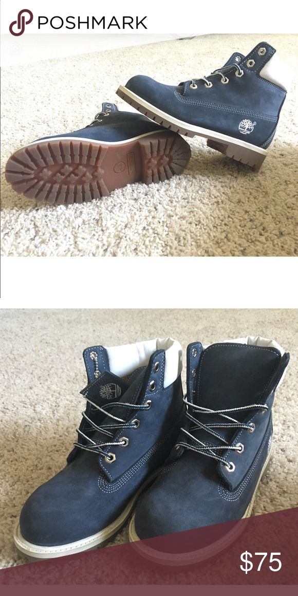 Blue Timberland boots Custom design, blue suede timbs. Never worn, new in box!  White leather upper, smoke free home. Beautiful shoes in a one of a kind design! 4.5 size mens- 6.5 size womens US Timberland Shoes