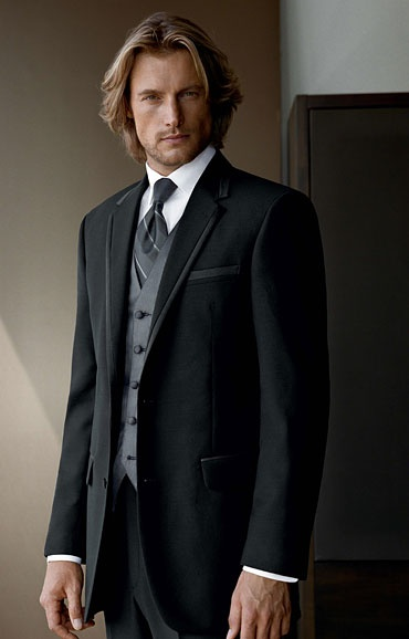 I don't know if you like this tie, but this guy is HOT!  Darker grey vest/tie with black suit - Model: Gabriel Aubry
