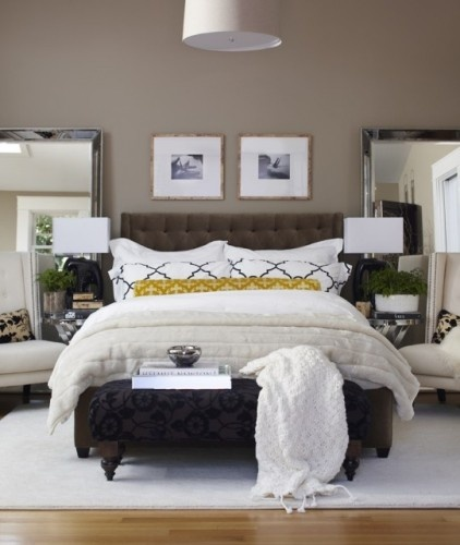 The layering, colors and pattern mix in this bedroom are fabulous. LOVE the mirrors.  We definitely have room in our master for chairs on both sides of bed. Hummm....now I have ideas!!