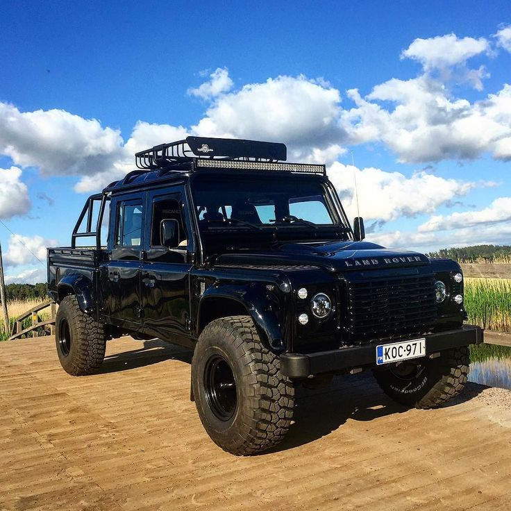 Land Rover Defender 130 DC Td4- Black with big wheels. Nice.