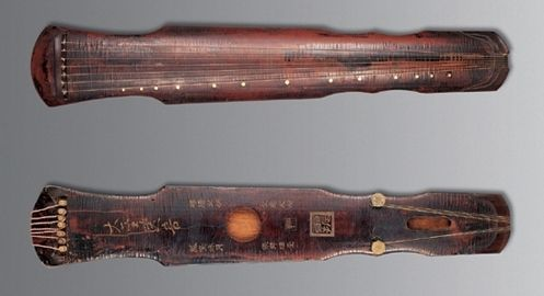 """Literally, Gu Qin means """"Ancient Musical Instrument"""". It is a seven string plucked Chinese musical instrument of zither family. Its sound is very peaceful, like resounding in a valley."""