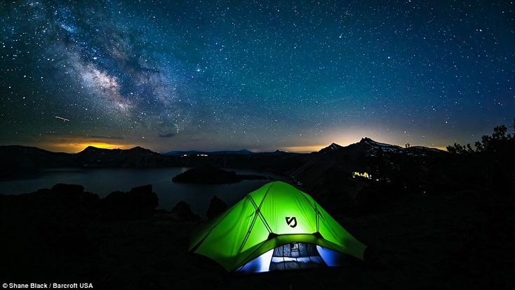 A glowing tent sits beneath the milky way in 2013, in Crater Lake, Oregon, in another of Shane Black.