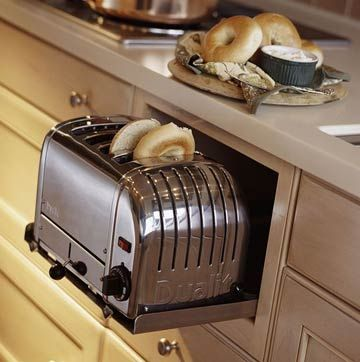 Built in toaster, I love this space saver idea