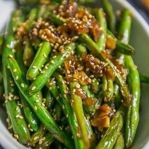 Quick, delicious Garlic Chinese Style Green Beans are a family favorite - just like takeout green beans but so much better! Under 120 calories per serving.