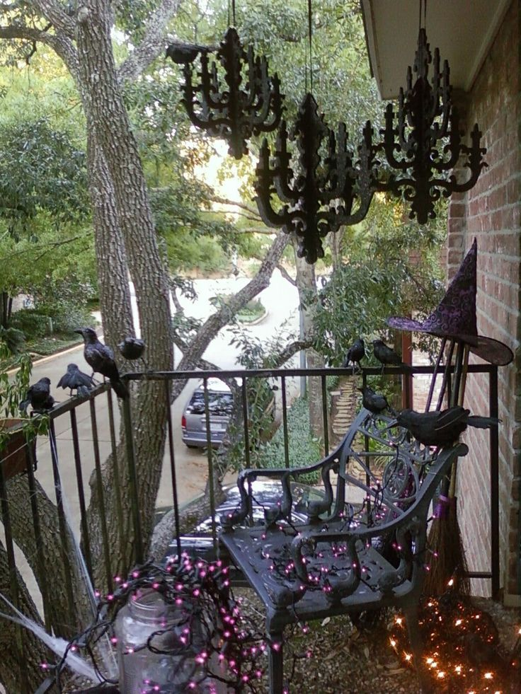 interior spacelift is easy halloween decorating with chandeliers webbing and crows - Do It Yourself Halloween Decorations For The Yard
