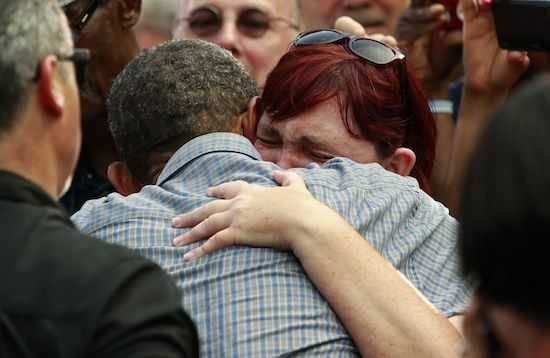 Stephanie Miller of Sandusky Ohio cries on the shoulder of U.S. President Barack Obama at a campaign event at Washington Park in Sandusky, Ohio July 5, 2012. Miller's sister died of cancer and said that Obama's healthcare plan would have given her better treatment options. ..REUTERS/Kevin Lamarque (UNITED STATES - Tags: POLITICS)