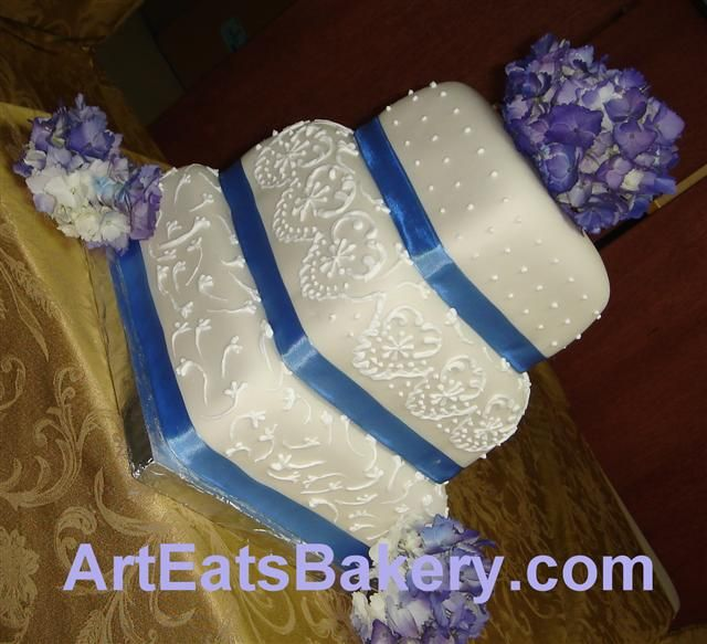 blue themed wedding cakes | wedding cake with blue ribbons 300x273 Royal Blue Square Wedding Cakes