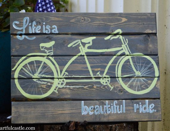 "Reclaimed wood sign with a hand-painted vintage style tandem bicycle with the saying ""Life is a beautiful ride""."