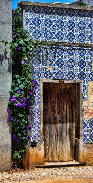 Blue and white tiled home / building exterior - Desert